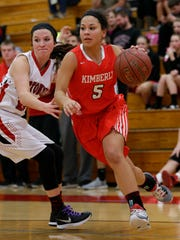 Kimberly High School's Alina Hampton (5) drives to the basket against Hortonville High School's Lexy Campshure (14) during their girls basketball game Tuesday, December 15, 2015, in Hortonville, Wis. 