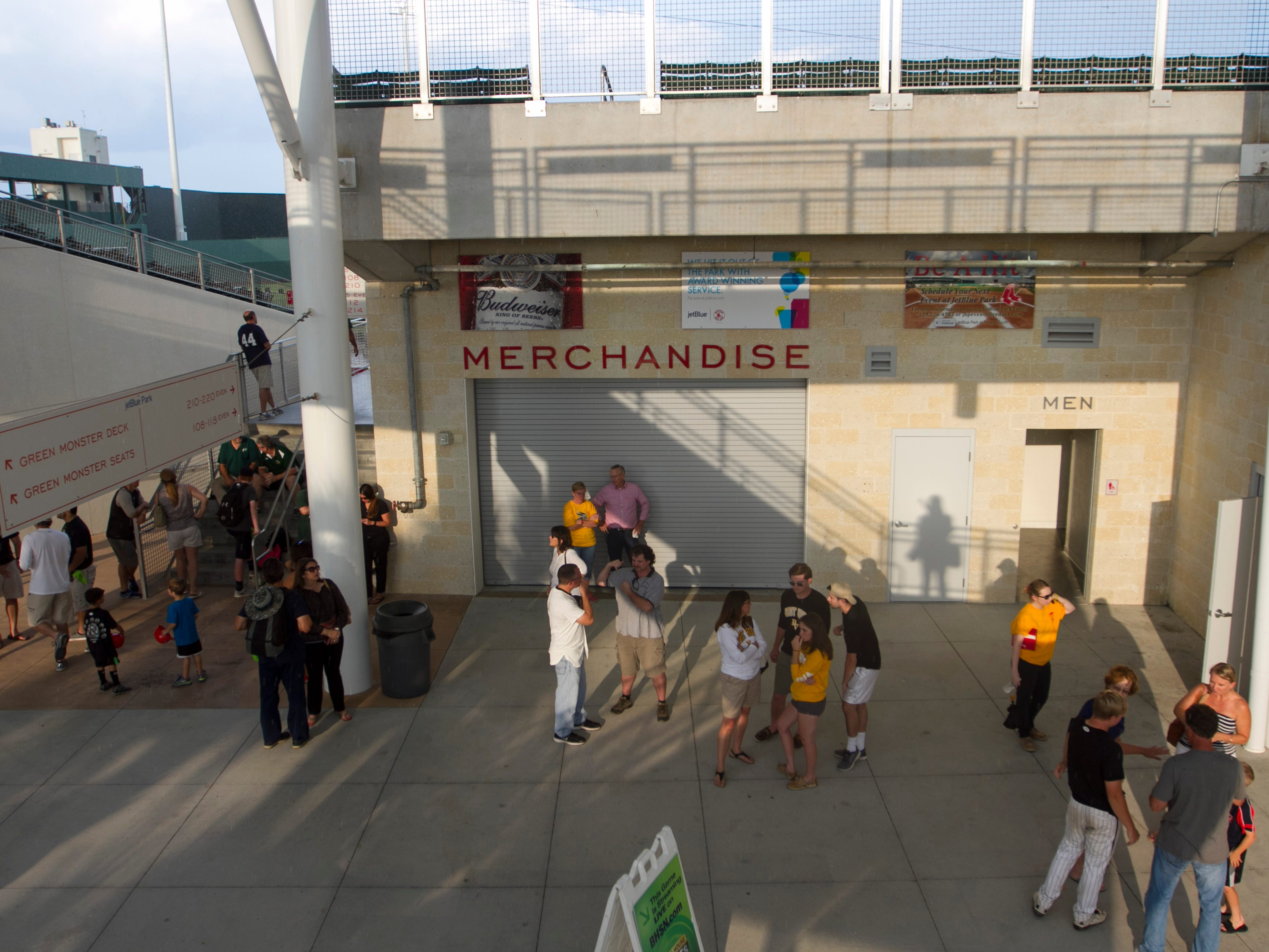 Fans wait during a lightning delay at JetBlue Park on Tuesday night. Bishop Verot was scheduled to play Jacksonville Trinity Christian in the 4A state championship.