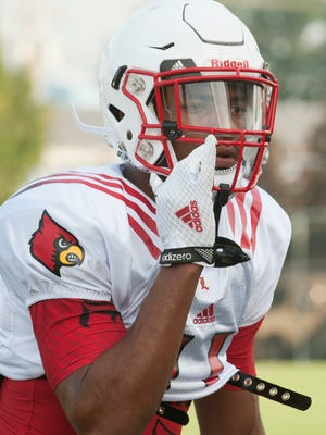 University of Louisville Cardinals linebacker Dee Smith yells to another player during a University of Louisville football practice.08 Aug 2015