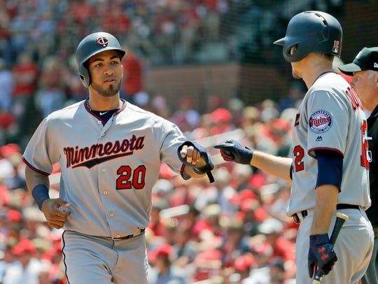 Minnesota Twins' Eddie Rosario (20) is congratulated