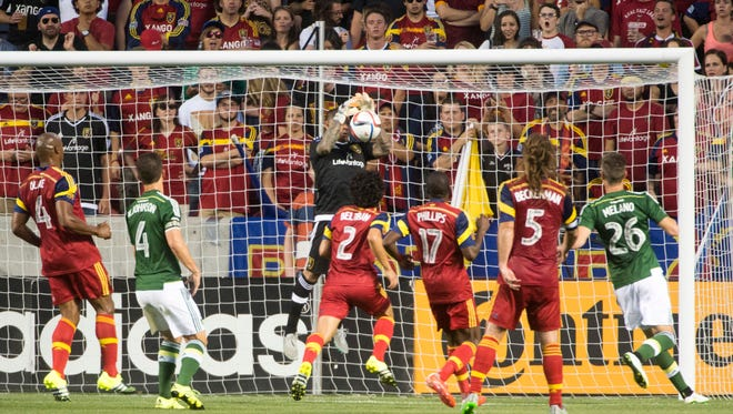 Real Salt Lake goalkeeper Nick Rimando makes a save against the Portland Timbers during an MLS soccer match Saturday, Aug. 15, 2015, in Sandy, Utah.