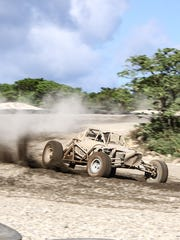 In this file photo, El Diablo Guapo cuts through the corner, kicking dust during the off-road buggies and trucks endurance race at Smokin' Wheels.