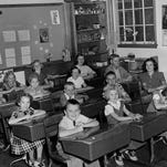 Irving Demonstration School on Algoma's Church Street offered Door-Kewaunee Normal School students practice teaching opportunities under the watchful eye of the classroom teacher. When Harold Heidmann snapped this photo in October 1955, Miss Flora Rock was in charge. Student teachers taught individual classes before going out to the rural schools for weeks of practice teaching. Within two years of the photo, Irving was closed and a new laboratory school was attached to the college, which is now the site of Algoma Public Library and City Hall. The lab school became the children's room of the library. Students are identified as Bonnie Robinson, Glenn Guilette, Carol Paape and David Dettman near the window. Pearl Dufek, Ellen Douglass, Larry Siporski and Betty Paape are in row three. Gladys Dufek, Janice Breitlow, Dale Dumman and Shirley Dettman make up the second row while Mary Douglass, Roy Dettman, Carol Breitlow and Mark Annoye are in front.