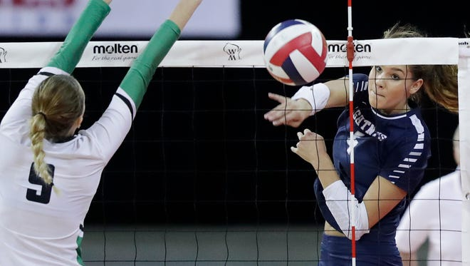 Lake Country Lutheran's Brooke Andersen (4) gets a kill against Regis in the Division 3 championship match at the WIAA State Girls Volleyball Tournament at the Resch Center on Saturday, November 4, 2017 in Ashwaubenon, Wis. Lake Country won the championship, 3-1.