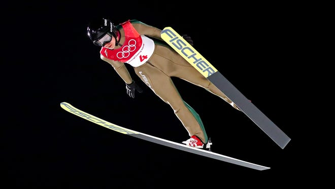 Nita Englund finishes 31st in her Olympic debut in women's ski jumping.