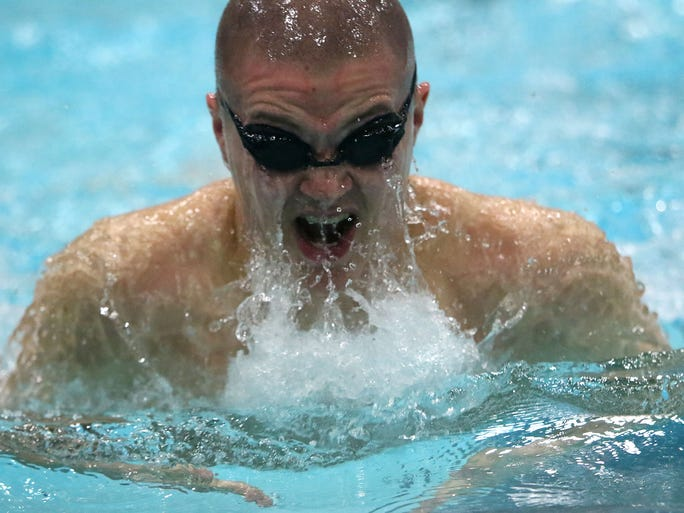 Waukesha South/Catholic Memorial's Gabe Castillo competes in the 200 Yard Medley Relay Event of the W.I.A.A. Boys Swimming and Diving Championships held in the University of Wisconsin Natatorium Saturday, Feb. 20, 2016, in Madison, Wisconsin.
