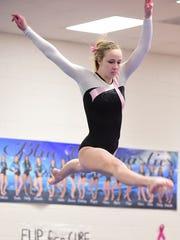 Livonia Blue's Jessica Weak placed third on the balance beam Wednesday night.
