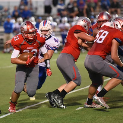 SJCC's Ross Snyder carries the football Saturday.