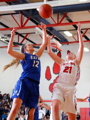 Bath's Emily Angell, left, and Laingsburg's Sophie Wilsey (21) reach for a rebound Thursday, March 3, 2016, in Laingsburg, Mich. Laingsburg won 41-27.