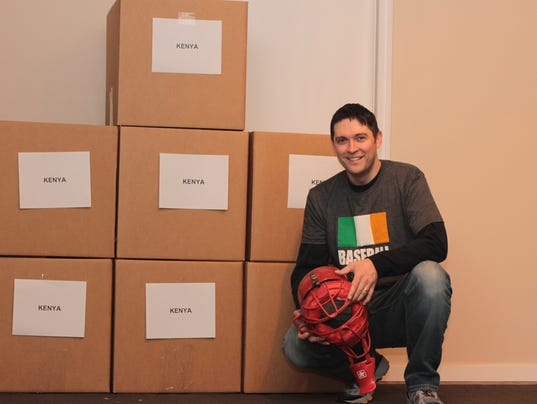 635936399899717863-John-Fitzgerald-of-the-Baseball-United-Foundation-with-some-of-the-boxes-destined-for-Kenya.jpg