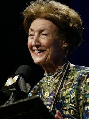 "FILE - In this Nov. 19, 2003 file photo, Shirley Hazzard makes her acceptance speech after winning the Fiction category at the 2003 National Book Awards in New York City, with her book titled ""The Great Fire."" The award-winning novelist Hazzard has died at her home in New York City at age 85. Hazzard's friend Frances Alston says the author died Monday, Dec. 12, 2016."