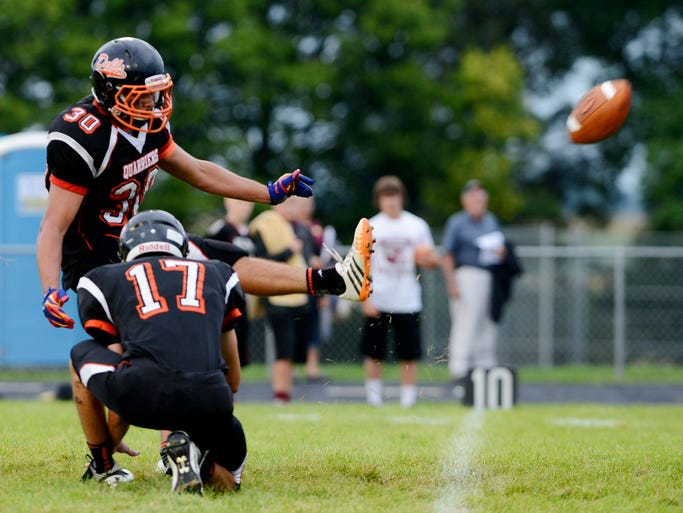 Dell Rapids' Keegan Hemenway makes an extra point attempt after a touchdown against Madison in Friday night's game in Dell Rapids, Aug 29, 2014.
