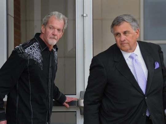 Colts owner Jim Irsay and attorney James Voyles leave the Hamilton County Sheriff's Office and Adult Detention center, March 17, 2014.