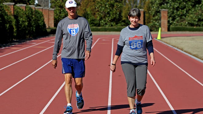 Donna Hertling and James Horne walk around the Furman University track on Sunday, January 15, 2017 where they train for the upcoming Greenville News Run Downtown 5K that will be held on January 21, 2017.