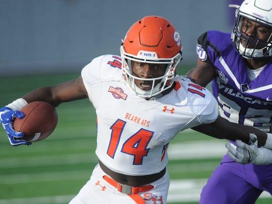 Sam Houston's Davion Davis (14) slips away from ACU's