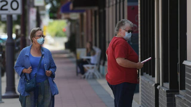 People walk around with masks in the downtown Ames on Tuesday, Aug. 4. File photo by Nirmalendu Majumdar/ Ames Tribune
