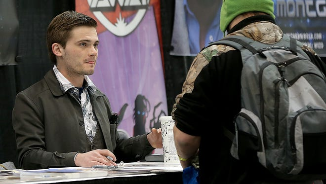 Jake Lloyd, who played the young Anakin Skywalker in the 1999 film Star Wars Episode I: The Phantom Menace, greets fans at the Wizard World Com Con in 2015.