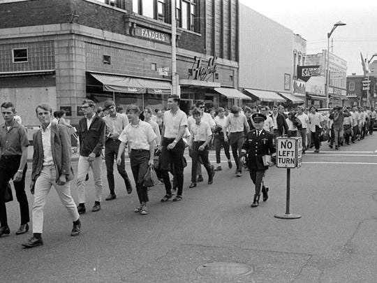 Members of the St. Cloud Platoon march up St. Germain Street on their way to a bus to take them into military service on Aug. 29, 1968. Many of those marching that day would end up serving in Vietnam.