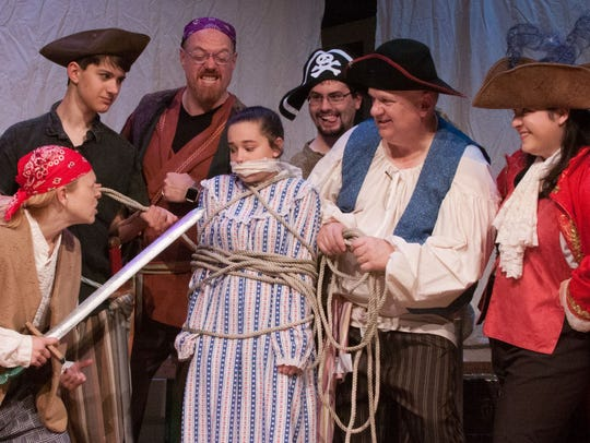 Mary, played by Makaela Cooper, is tied up by pirates