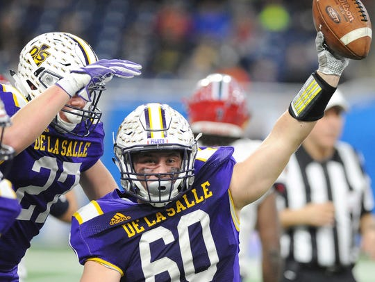 Warren De La Salle's Mike McGinnity registered five tackles in the Division 2 title win over Muskegon Mona Shores.