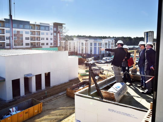 From the balcony of the BankPlus Central Mississippi Headquarters, Ted Duckworth, left, principal partner of The District at Eastover, identifies several buildings that make up the northeast Jackson development.