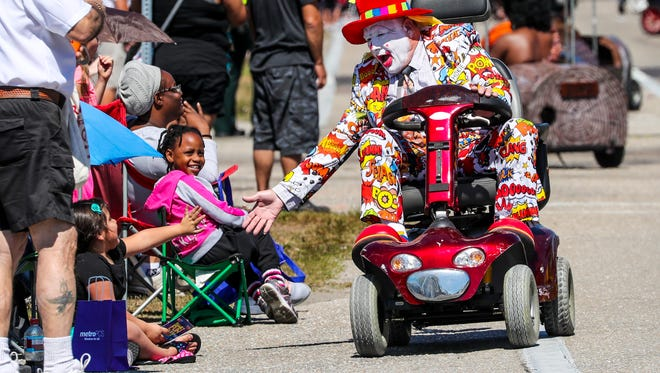 A clown with the Araba Shriners slaps hands with a young girl as he rides by. The 2017 Lehigh Spring Festival Parade traveled along Homestead Road from Beth Stacey Boulevard to Arthur Avenue. Folks were happy to see that the parade is back.