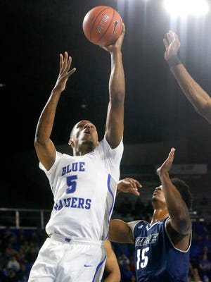 MTSU's Nick King (5) goes up for a shot as Rice's Bishop Mency (15) defends him on Thursday, Feb. 8, 2018, at MTSU.