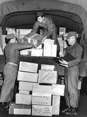 Soldiers unload Christmas boxes during the war.