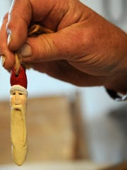 A Christmas ornament carved by Ron McLaughlin is displayed.