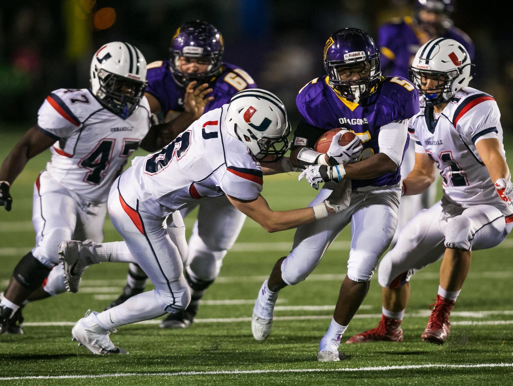 Johnston's T-Boy White tries to break a tackle during their Friday's home game against Urbandale. White rushed for 100 yards on 15 carries, scoring two touchdowns in a 24-17 Dragons win. Johnston is now 3-0, with all victories coming by a touchdown or less.