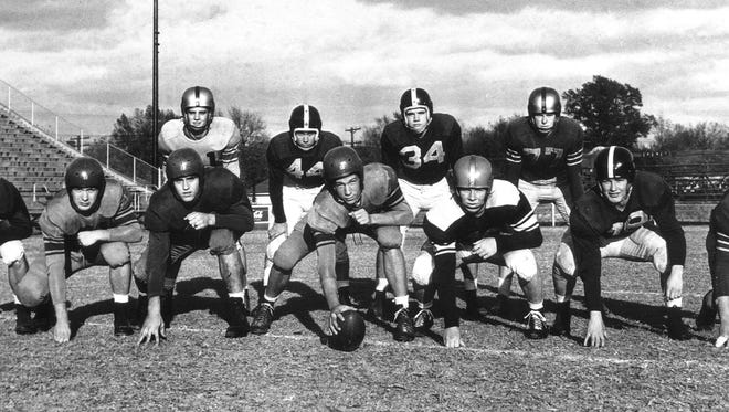 Members of the 1949 All-Memphis Prep Football team lined up for a team photograph on November 2, 1949, include (from left)  Front Row:  Wilbur Conley (Right End) South Side; Charley Schmidt (Right Tackle) CBC; Tommy Campbell (Right Guard) Central; Bobby Cottam (Center) CBC; Jerry May (Left Guard) Humes; Joe Vickers (Left Tackle) South Side and Hugh Ballard (Left End) Tech.  Back Row:  Backs - Jimmy Cole (Messick), Gene Bigham (South Side), Billy Russell (South Side) and Joe Gaynor (Tech).