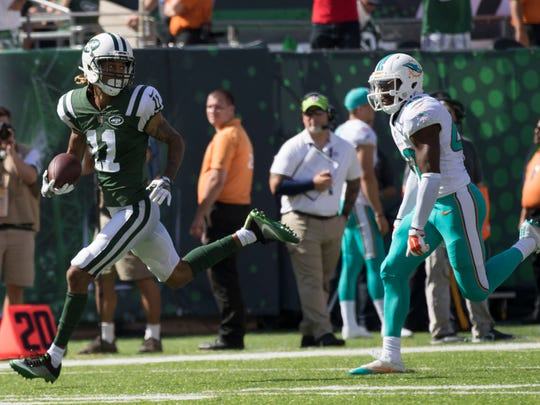 New York Jets wide receiver Robby Anderson scores a touchdown against Miami Dolphins defensive back Alterraun Verner during the second quarter at MetLife Stadium.