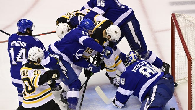 Boston Bruins left wing Nick Ritchie (21) scores on Tampa Bay Lightning goaltender Andrei Vasilevskiy (88) during a scramble in front of the net during the first period of Game 2 of an NHL hockey second-round playoff series, Tuesday, Aug. 25, 2020, in Toronto.