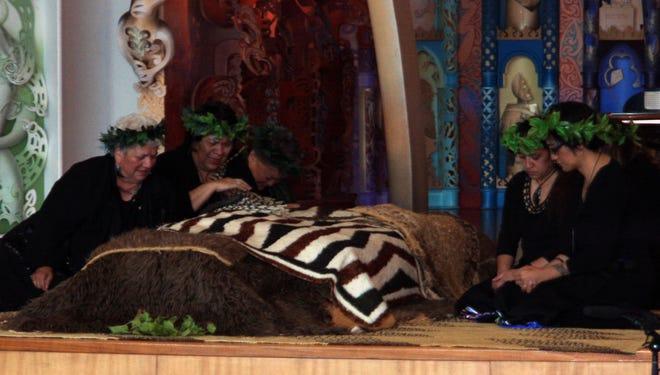 Maoris mourn over their ancestors' remains at Te Papa Museum Marai meeting house in Wellington, New Zealand.