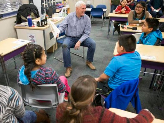 "Gov. Mike Pence laughs with kids during a humorous part of the story at he reads ""The Old Man Who Loved Cheese,"" by writer Garrison Keillor and illustrator Anne Wilsdorf, at the Shepherd Community Center on Friday, Jan. 16, 2016."