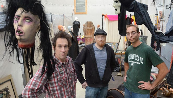 "Milford's Suzanne Haskew Arts Center has been transformed into the Haunted SHAC - Gallery of the Disturbed for this weekend's Halloween-themed event. Pictured in the attraction's ""demented artists"" area are, from left: John Kozicki, Joe Brancik and Isaac Perry."
