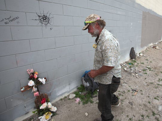 Homeless man George Moyer, 53, marks the area where Denee Salisbury died with a memorial he made. Photo taken on Wednesday, March 11, 2015 next to the shuttered MaGruder Chevrolet Dealership in Palm Springs.