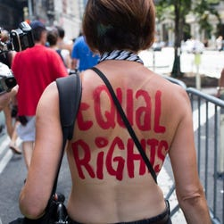An activist marches in the GoTopless Day Parade on Aug. 23, 2015, in New York.
