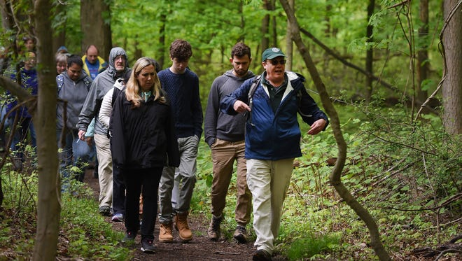 Historical interpreter Eric Nelsen (R) leads an annual tradition of a special Mother's Day Hike along the summit of the Palisades Interstate Park in Alpine on 05/13/18.