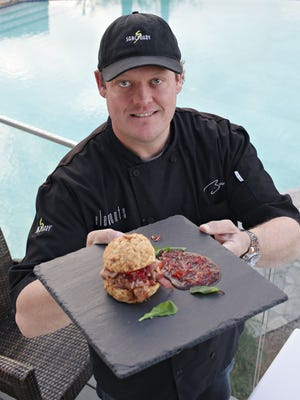 Chef Beau MacMillan of Elements at Sanctuary shows his cheese biscuit and ham slider in Phoenix. Top chefs will join MacMillan for the return of the Lunch & Learn series Saturdays throughout August.