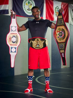 Frank Martin is the first boxer from Indy to win the Golden Gloves national title since 1984. Martin worked out with his coach, Ike Boyd, Jr., Saturday, May 28, 2016.