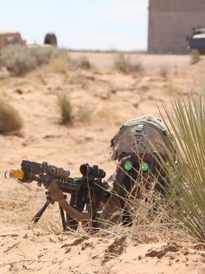 """A soldier with 3rd Battalion, 41st Infantry Regiment from Fort Bliss keeps an eye out for the """"enemy"""" during Iron Focus. The Rifles Battalion served as the opposing force for 3rd Brigade during the exercise."""