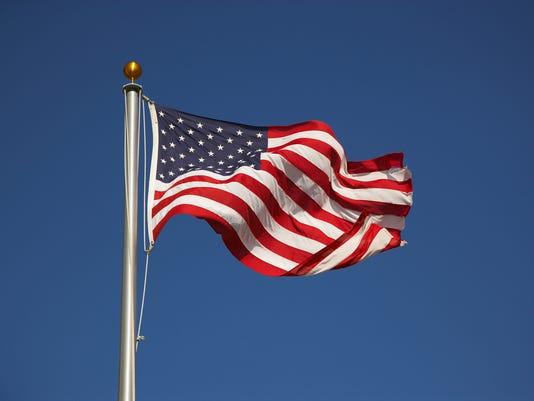 American flag on pole waving in breeze
