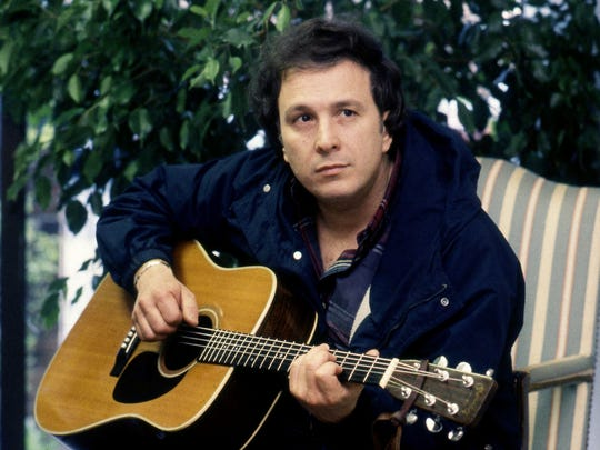 Don McLean strums a few chords in the Music Row office of Capitol/EMI Records on March 24, 1987.