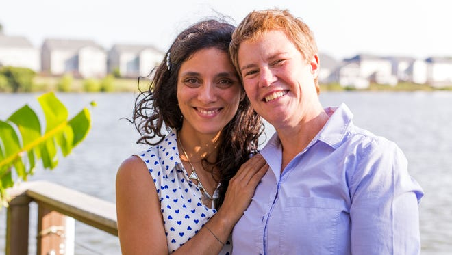 Valeria Tanco, left, poses with her wife, Sophy Jesty, at their home Thursday, June 23, 2016, in the Charleston, S.C., area. The couple were among the plaintiffs last year in the Supreme Court case that upheld same-sex marriage, and recently moved from Knoxville.