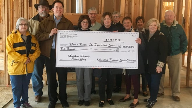 A check for $40,000 recently was presented to Ida Rupp Public Library Board President James Widmer and Director Tim Hagen.