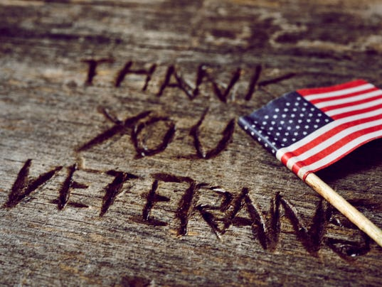 text thank you veterans and the flag of the US