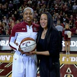 South Carolina's Tiffany Mitchell, left, is presented with a ceremonial ball by coach Dawn Staley for breaking the 1,000 career-point mark, before an NCAA college basketball game against Auburn on Friday in Columbia.