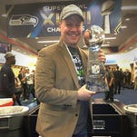 Seattle Seahawks Director of Pro Personnel Trent Kirchner poses with the Lombardi Trophy the team captured by winning the Super Bowl last season. Kirchner, a 2000 St. John's graduate, will again be with the team as it goes for a second-straight title on Sunday.