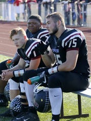 Dan Fedor (75) takes a break with teammates during Elmira's 53-28 victory over Corning on Oct. 14 at Ernie Davis Academy.